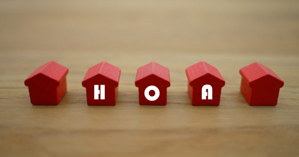 HOA written on small red houses